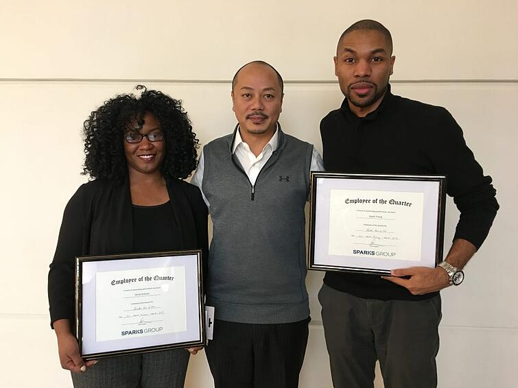 Employees of the Quarter, Sheila Roberts (left) and Jamal Young (right) with Howie Huang (center), Vice President for Sparks Group