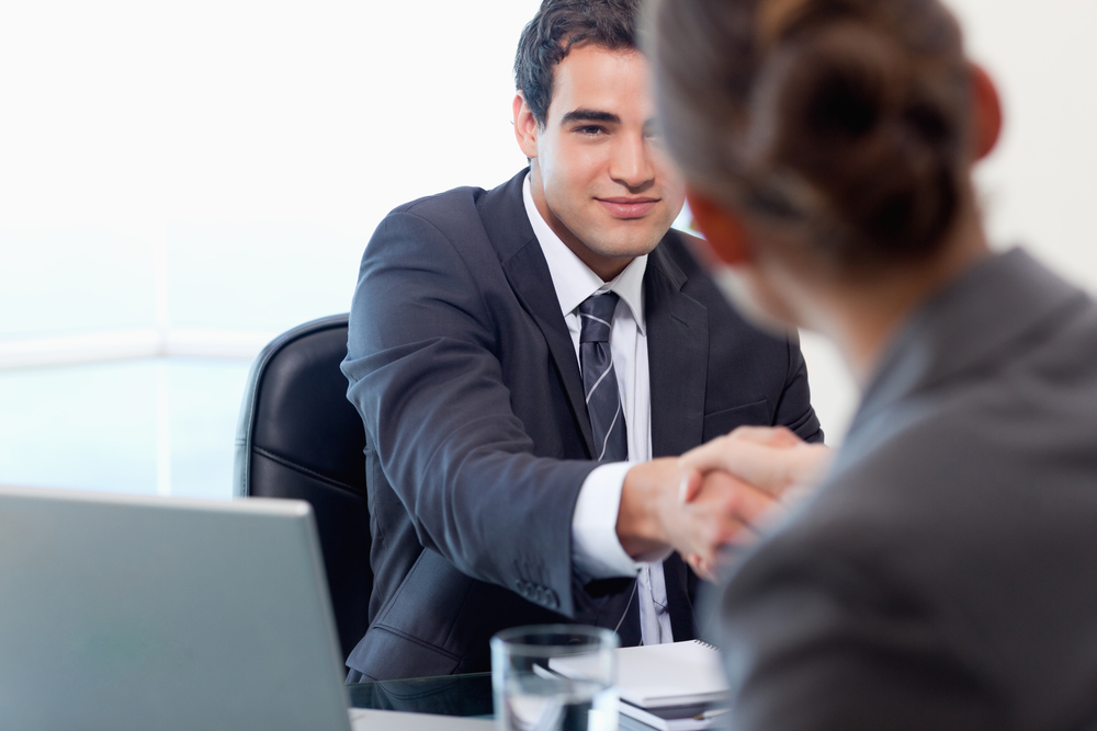 Manager interviewing a female applicant in his office-3