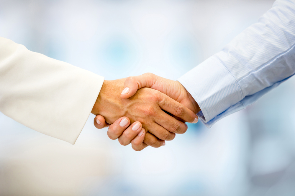 Successful business people handshaking closing a deal-4