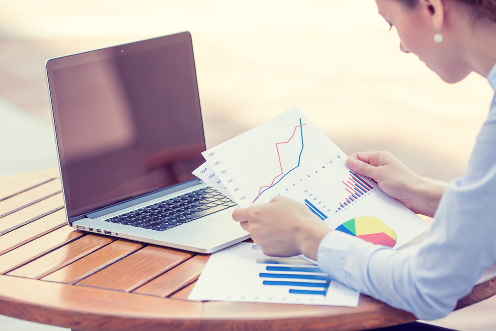 woman investment consultant analyzing company annual financial report balance sheet statement working with documents graphs. Stock market, office, tax, education concept. Hands with charts papers-2